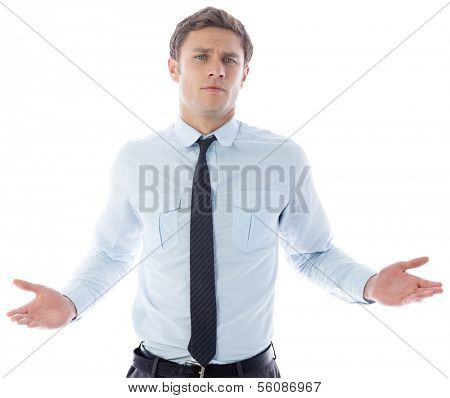 Puzzled businessman on white background