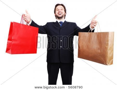 Young Attractive Man Wearing Suit And Holding Shopping Bags