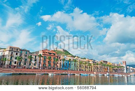 Boats Under Clouds In Bosa