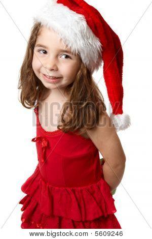 Niña sonriente en Red Hat de Santa