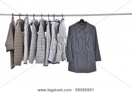 Set of female coat clothing on hangers