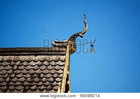 Gable apex emblazoned on the roof of the temple Thailand