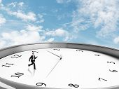 foto of rune  - businessman runing in clock on a sky background - JPG