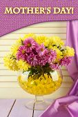 Beautiful flowers in vase with hydrogel on table on wooden background poster