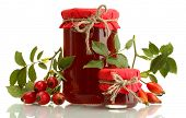 stock photo of dog-rose  - jars with hip roses jam and ripe berries - JPG
