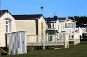 stock photo of trailer park  - Row of static trailers in caravan park - JPG