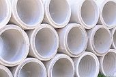 image of sewage  - Concrete drainage pipes stacked on construction site - JPG