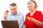 elderly couple doing online shopping