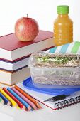 pic of lunch box  - Well prepared school lunch with books and pencils on white isolated background - JPG