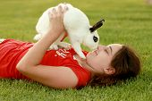 A Child and Her Pet Bunny Playing Outdoors