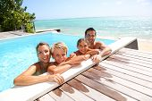 image of infinity pool  - Happy family enjoying bath time in infinity pool - JPG