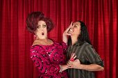 image of drag-queen  - Embarrassed drag queen pushing away kissing man - JPG