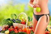 picture of obese  - Dieting. Balanced diet based on raw organic vegetables