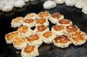 image of crab-cakes  - Mini crab cakes cooking on a hot griddle - JPG