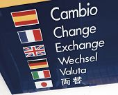 foto of spanish money  - sign outside money exchange shop in six languages - JPG