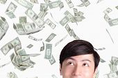 image of bundle money  - closeup of young man looking up money falling isolated on white background asian man - JPG