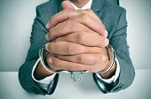 stock photo of wrist  - a man wearing a suit sitting in a desk - JPG