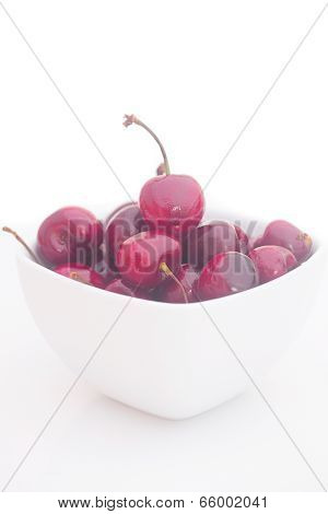 Cherries  In White Bowl Isolated On White
