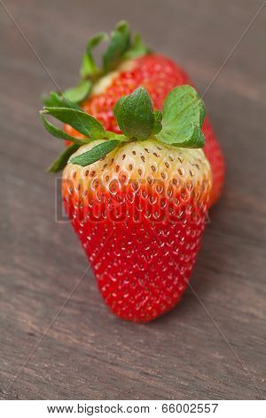 Red Juicy Strawberry  On A Wooden Surface