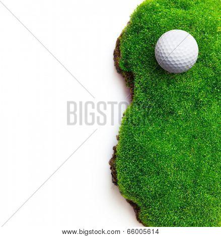 Golf ball on green grass field.