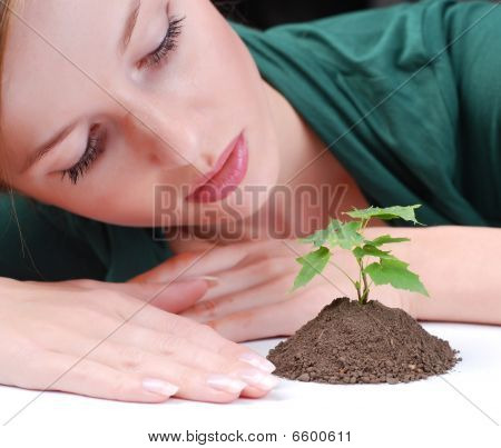 Green Sprout And Young Woman