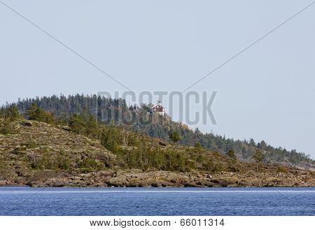 Hogbondens lighthouse, beacon at UNESCO High Coast Heritage, Sweden.