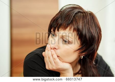 Tired Woman Holding Head, Looking Out