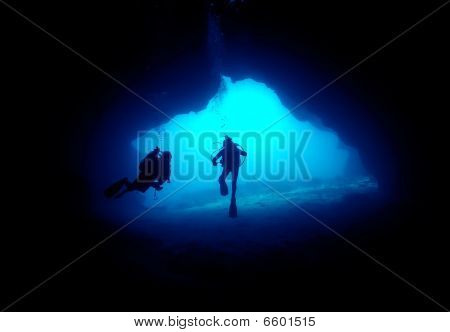 Divers in a cave.