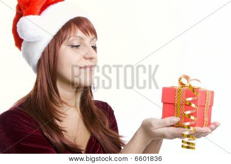 Christmas gift in hands of the woman