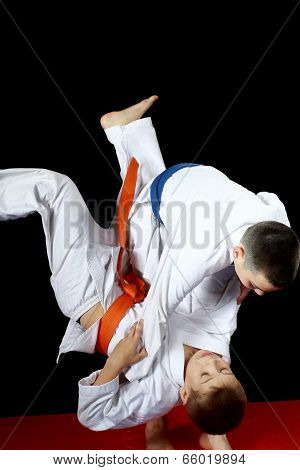 Training nage judo in the performance of an athlete with a blue belt