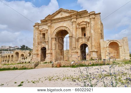 JERASH, JORDAN - MARCH 18, 2014: Hadrian's arch in the ancient city of Jerash. Since 2004, Jerash Archaeological City is included in UNESCO Tentative List