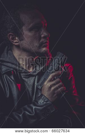 Assassin, man with black coat and gun
