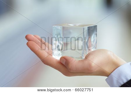glass cube in the hand