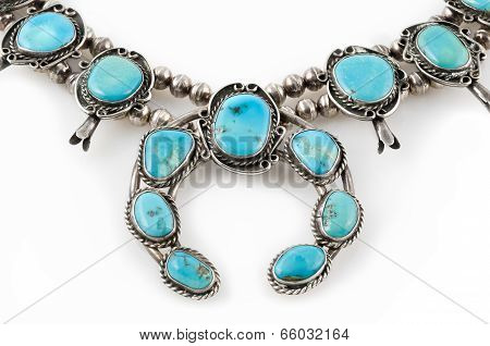 Detail of Silver and Turquoise Squash Blossom Necklace.