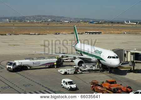 VALENCIA, SPAIN - JUNE 3, 2014: An Alitalia aircraft at the gate at the Valencia airport. Alitalia is the flag carrier and national airline of Italy and one of the biggest airlines in Europe.