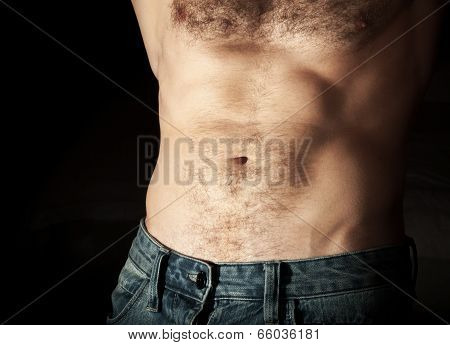 Flat Sporty Male Belly. Close Up Photo On Dark Background