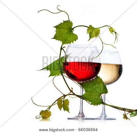 Wine. Two Glasses of red and white wine decorated with grape leaves. Glass of wine isolated on white background. Rose. Vine leaf.