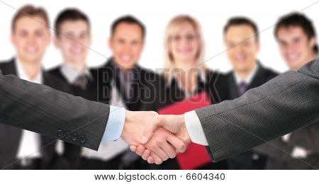 Shaking Hands With Wrists And Six Business Group Out Of Focus Collage