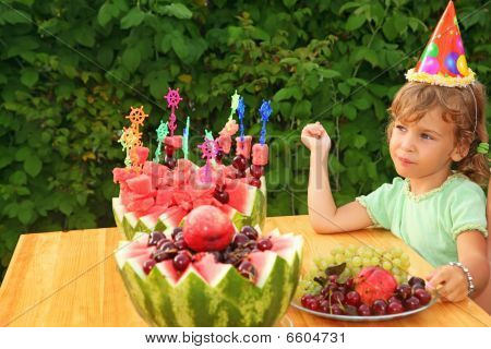 Little Girl Eats Fruit In Garden, Happy Birthday Party Seven Years
