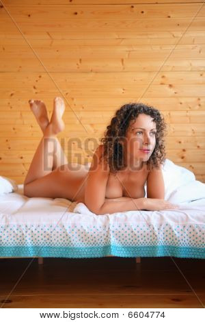 Naked Beautiful Hot Woman Lying On Bed In Cosy Wooden Room