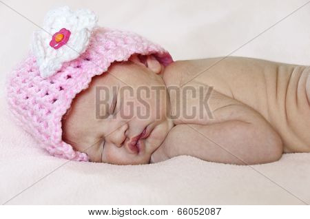 Closeup of newborn baby with pink hat