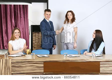 Business people at tribune in conference room