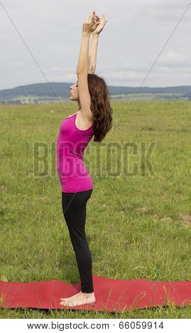 Young Caucasian Woman In Upward Salute Pose During Yoga In Nature