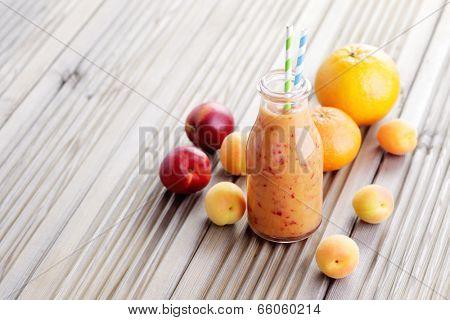 bottle of orange fruity smoothie - food and drink
