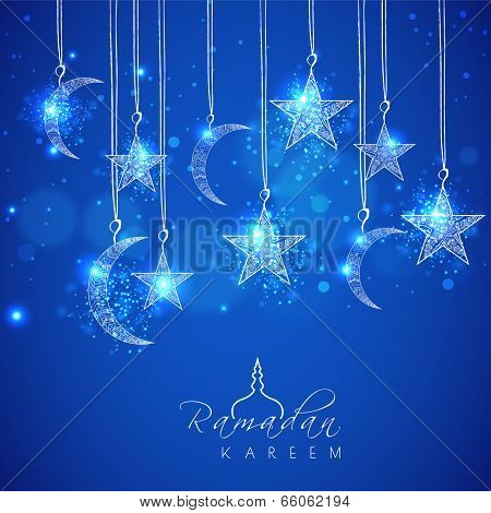 Hanging shiny moons and stars on blue background for holy month of muslim community Ramadan Kareem.