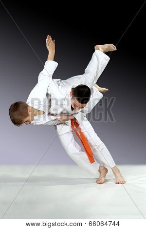 Little sportsmen is doing judo throws