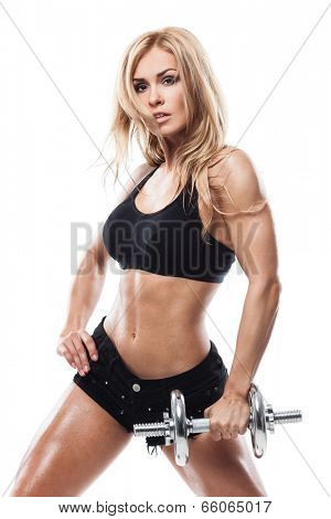 Smiling athletic woman pumping up muscles with dumbbells on white background