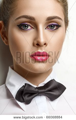 blondie woman in white shirt and black bow-tie