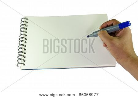 Man Writing With A Marker On A Spiral Bound Book