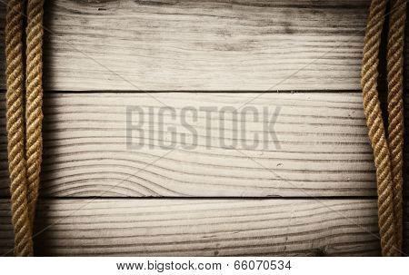 Ropes on wooden background